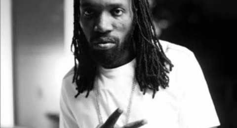 Mavado showing peace sign for 2012