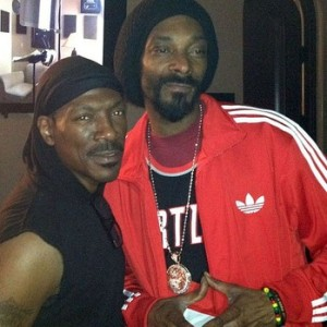 Eddie Murphy (left) and Snoop Lion (right) have formed an unlikely combo on a new Reggae song, called 'Redlight.' Credits:   potholesinmyblog.com