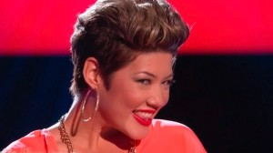 Tessanne Chin has every reason to smile after advancing to the knockout round of 'The Voice' after edging out Donna Allen during their performance on Monday night.
