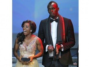 Shelly-Ann Fraser-Pryce (left) and Usain Bolt (right) accept their 2013 IAAF World Athlete of the Year awards at a gala in Monaco on Saturday.. Associated Press (AP)